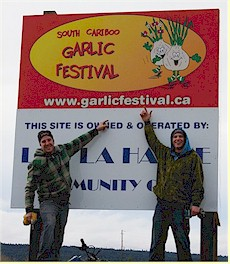 www.garlicfestival.ca - The signs on Hwy 97, north of Lac La Hache.  Sign installation by Paul Duff (left) and Don Norris (right).  Photo by Lloyd McTaggart